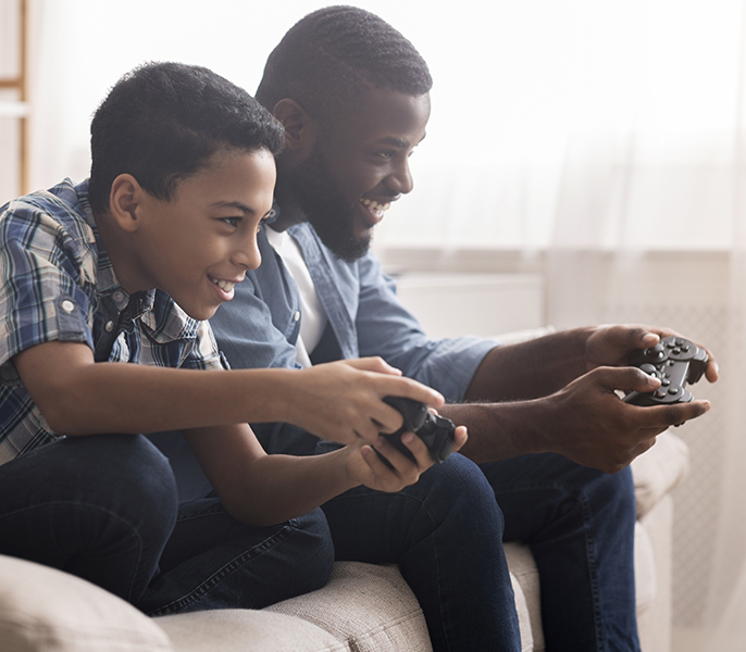 Family gaming in their living room with Spectrum Internet