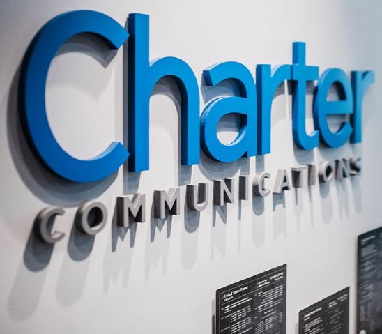 Charter Communications Logo on a Wall