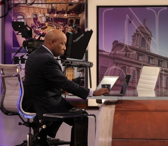 Spectrum News - Errol Louis at the news desk